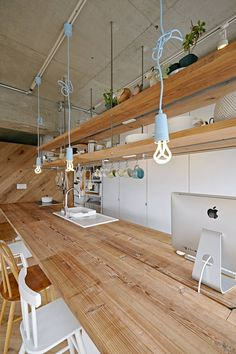 House is a minimalist residence located in Kanagawa, Japan, designed by TENHACHI. Suspended Shelves, Floating House, Office Decor, Track Lighting, New Homes, Minimalist, Ceiling Lights, Interior Design, Building