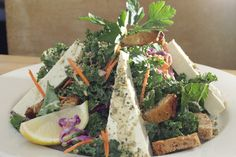 The Vegan Kale Caesar: curly kale, organic tofu, organic carrots, gomasio and miso-lapsang dressing served with organic bread.