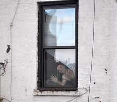 Hyemi Cho paints figures waving at strangers in her window overlooking the high line