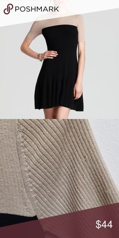Theory Crisela B Preen Color Block Dress Merino wool colorblock dress with short sleeves and an A-line skirt. There are two very small holes in the right sleeve as shown but they are not noticeable when worn. Theory Dresses Mini