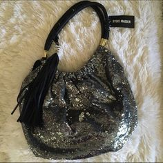 Steve Madden Sparkle Bag  NWT. Authentic Steve Madden Bag. Pewter sequins with black trim and tassel. Gold tone hardware. Price firm. No trades.  Steve Madden Bags