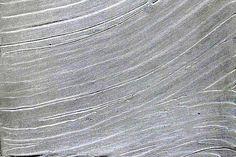 verometallo, superficie in polvere di alluminio ricomposto, con lavorazione a rilievo