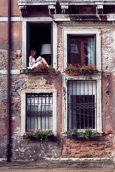 ღღ Venice, Italy. ~ Could be me. Used to sit on the window seal all the time and read....