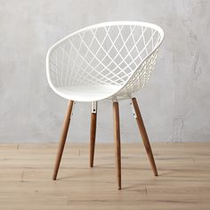 Shop sidera white chair.   High-tech construction meets classic modern design.  Made in Italy, sleek molded plastic sculpts a woven crosshatch pattern on tapered solid ash wood legs.