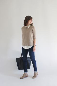 Beige sweater, white shirt, dark wash skinny jeans, suede taupe booties