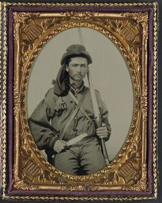 A soldier in Confederate infantry uniform with musket and Bowie knife.