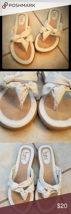 Good Condition BOC Sandals! Selling a Pair of Good Condition BOC Sandals! These are very cute! Comfortable with the quality BOC offers! Neutral creamy white, can go with lots of outfits for the summer! Some noticeable wear, needs wiped down. Size 7 BOC Shoes Sandals