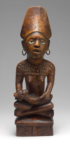 Figure: Mother and Child, 19th-20th century Democratic Republic of Congo or Angola, Kongo peoples, Yombe group Wood, glass, metal, pigment