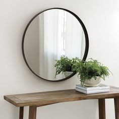 With its clean, unadorned lines, the Thomas Round Mirror epitomizes modern simplicity. The flat metal frame creates a light-filled banded border with just enough depth for contrast with the clear mirror. Thomas Round Mirror features:Hardwood back Black Round Mirror, Round Mirrors, Round Wall Mirror, Mirror Mirror, Circular Mirror, Box Bed, Boho Living Room, Living Rooms, Ballard Designs