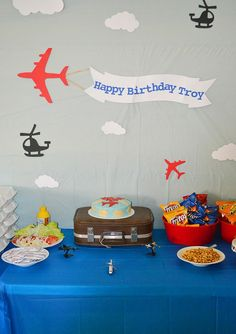 Airplane birthday party - love the sign, and the suitcase as a cake stand