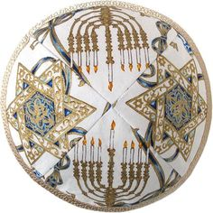 Highly original kippah for Hanukkah.  The background color is cream white with images of Menorah and Star of David.  There are touches of metallic gold.