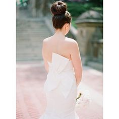 A fun #bridal #topknot and a chic #weddingdress! #bride #weddinghair   Photography: @_carolineyoon   Wedding Dress: @amsalebridal   Hair & Makeup: @theblondebrunetteaz by smpweddings