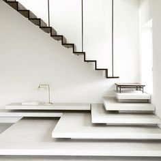 A smoked-oak staircase suspended from steel poles joins a flight of tapered terrazzo steps in this Copenhagen apartment, which has been overhauled by local practice jacstudios. Oak Stairs, Metal Stairs, Concrete Stairs, Modern Stairs, House Stairs, Stair Handrail, Staircase Railings, Staircase Design, Stairways