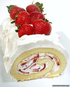 Vanilla sponge cake spread with strawberries and whipped cream