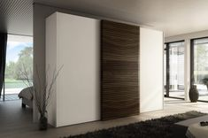 'Multi-forma II Sliding' At first glance, the main difference of The Soloist compared to other front solutions is the elaborate wood appliqué of the central sliding door. This design always features three doors and is available in four widths. There is a choice of ten finishes for the doors either side. Integrated handles are possible in five versions.