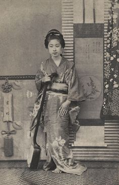 Geisha with a shamisen, ca.1863-1876 by Shimooka Renjo