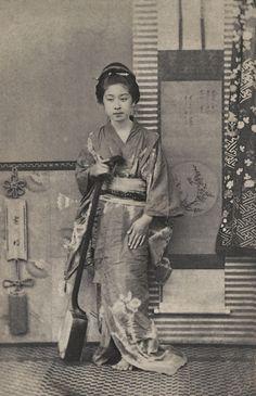 Geisha with a shamisen, ca.1863-1876 by Shimooka Renjo