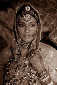 I think she is sooo pretty. I love rajasthani bridal outfits