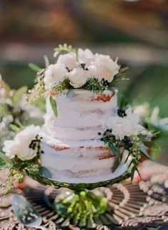 Rustic floral topped naked cake: http://www.stylemepretty.com/2015/11/20/elegant-cozy-winter-wedding-inspiration/ | Photography: Jordan Brittley - http://jordanbrittley.com/