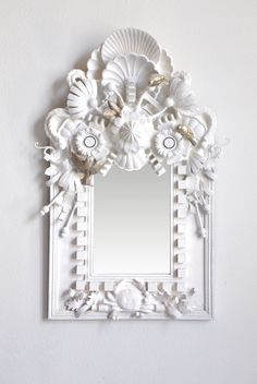 Just gorgeous. Almost a white take on Louise Nevelson. Objet trouvee mirror. Codor Designs.