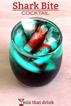 Shark Bite cocktail with spiced rum, blue curacao, light rum, sour mix and grenadine. Great Halloween drink! Get this drink recipe at http://mixthatdrink.com/shark-bite/