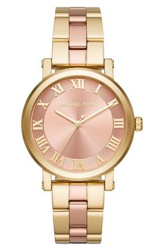 Gold-tone Roman numeral indexes on this exquisite rose sunray dial pair beautifully with the two-tone bracelet.