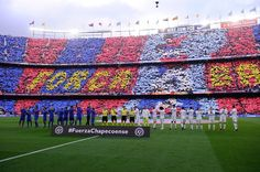 Barcelona and Real Madrid players applaud after observing a minute of silence to remember the victims of the Chapecoense football team before the Spanish league football match FC Barcelona vs Real Madrid CF at the Camp Nou stadium in Barcelona on December 3, 2016. / AFP / JOSEP LAGO