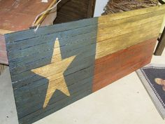 "He makes a smaller one for less - perfect for Hose A's bathroom - Lg Wooden Texas Flag 47"" x 19  Country Primitive Red White Blue Star. $44.99, via Etsy."