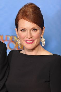 Julianne Moore in Bulgari  Meanwhile, Julianne Moore, another Bulgari face, accessorized her monochrome Tom Ford gown with yellow gold and diamond pendant earrings from the Italian house.