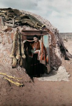 A girl stands in front of her hut on the Painted Desert in Arizona in 1929. PHOTOGRAPH BY CLIFTON R. ADAMS, NATIONAL GEOGRAPHIC