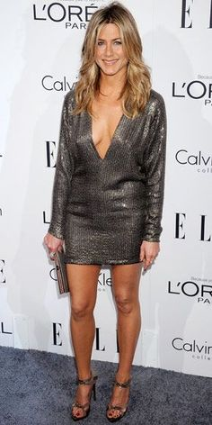 OCTOBER 17, 2011 At the Women in Hollywood event, Aniston took the plunge in a sequin Kaufmanfranco minidress accessorized with a stingray Salvatore Ferragamo clutch, Fred Leighton diamonds and silver Balenciaga stilettos.