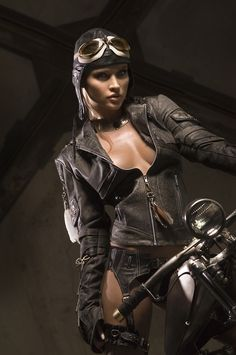 Probably never been on a bike in her life, but I still liked the whole Steam Punk look. - Choppers & Lace by photographer Derek Caballero.