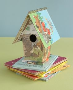 I LOVE this idea!! Mod Podge pages over an arts & crafts store or homemade birdhouse, using the cover as a roof!