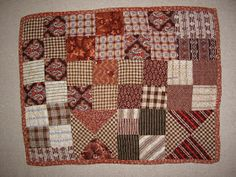 Time to pull out the fall decorations...here are a few doll quilts I enjoyed pulling out of the cupboard. The charm of antique doll qu...