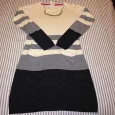 Tommy Girl sweater dress Adorable and soft Tommy Girl sweater dress with pockets. Form fitting. It's a medium but I think it fits more like a size 2. Very comfortable and great with boots! EUC. Tommy Hilfiger Dresses Midi