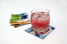 set of fabric coasters painted and splashed in very by Vebo