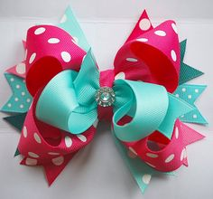 GLAM layered over-the-top bow topped off with a rhinestone center!