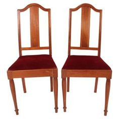 """Set of two vintage English side chairs with straight slat backs and rosewood inlay. Removable seats.  Product: Set of 2 chairsConstruction Material: Mahogany and polyblendColor: Red, brown and blackFeatures:  Made in the United KingdomSlat backsRemovable seats Dimensions: 39.5"""" H x 17"""" W x 17"""" D eachNote: Due to the vintage nature of this product, minor wear and tear is to be expected. Products may show signs of brand marks, scrapes or other blemishes."""