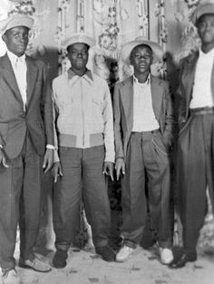 Zoot suits, which became popular in the 1930s and '40s, consisted of high-waisted, wide-legged pants with a long dress jacket. Although these 1940s gentleman are sporting a more subdued style, they're rocking the signature watch chain that was a must-have zoot suit accessory.
