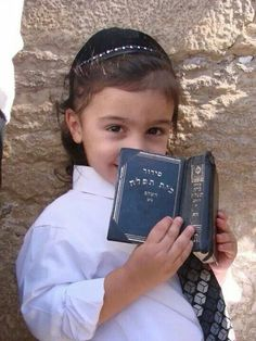 ~ Israël. A precious little one standing at the Kotel with his siddur. May the blessing of YHVH will always be with him. What a precious little cutie! ~