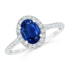 Oval Sapphire Halo Ring with Diamond Accents. Sleek and delicate, this solitaire ring is a lavish choice to celebrate your commitment.