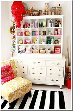 Salvaged dresser spiffed up with a variety of drawer pulls; cubby unit built to place on top of the dresser and both pieces painted the same to appear unified as one unit