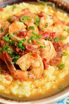 Shrimp and Grits is a wonderful southern classic that consists of buttery, cheesy grits topped with juicy shrimp that's been cooked with bacon and sub dried tomatoes. Shrimp And Grits Recipe New Orleans, Shrimp And Grits Recipe Charleston, Southern Shrimp And Grits, Shrimp And Cheesy Grits, Shrimp Grits, Shrimp And Grits Recipe With Bacon, Shrimp Chowder, Cooked Shrimp, Garlic Shrimp