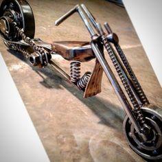 Custom metal chopper sculpture. Z bar handlebars, 45° rake, springer front end, coffin gas tank, chainsaw chain drive chain.