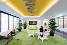 Gensler Completes Most Recent Office for Autodesk | Loll Designs's Adirondack chairs stand on recycled-nylon carpet tile in a lounge.
