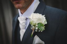 Groom's buttonhole made with Avalanche Rose, lisianthus and gypsophilia. Rose And Gypsophilia Bouquet, Groom Buttonholes, Classic Wedding Inspiration, Artificial Wedding Bouquets, Button Holes Wedding, Wedding Flowers, Wedding Dresses, Love Is Sweet, Groomsmen