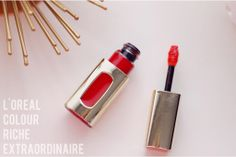 {what's trending!}  A great review on the L'Oreal Colour Riche Extraordinaire lip color in the shade Orange Tempo.