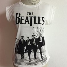 "Beatles T-Shirt (Host Pick6/3) Beatles Black and white t-shirt  front is 21"" long...back is 24"" long NWT didn't come with care instructions but I would suggest hand wash and line dry ❌trades ❌PayPal Pink USA Tops Tees - Short Sleeve"
