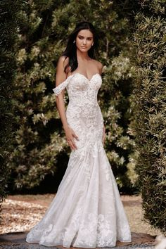 Finished with off-shoulder cap sleeves, this fit and flare appliquéd gown is all things glamorous and romantic and is available at the Atlas Bridal Shop. Atlas Bridal Shop is a bridal & wedding dress shop in Toledo, Ohio. Find wedding dresses, bridal gowns, veils & hair accessories, plus size, sleeves, beach, destination, formal, wedding dress styles. Wedding dress designers include Morilee, Allure Bridal, Allure Couture, Maggie Sottero, Rebecca Ingram, Sottero Midgely and more.   Wedding Dress Sizes, Bridal Wedding Dresses, Designer Wedding Dresses, Bridal Style, Bridesmaid Dresses, Allure Couture, Bridal And Formal, Formal Wedding, Dream Wedding