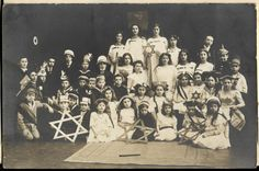 Jewish children dressed in costumes pose for a group portrait surrounded by large Stars of David. - Collections Search - United States Holocaust Memorial Museum Life Before the Holocaust World War Two
